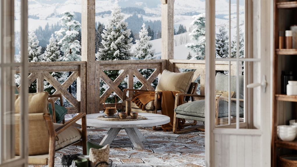A cozy winter cottage isn't complete without lots of pillows, warm tones, and a connection to nature