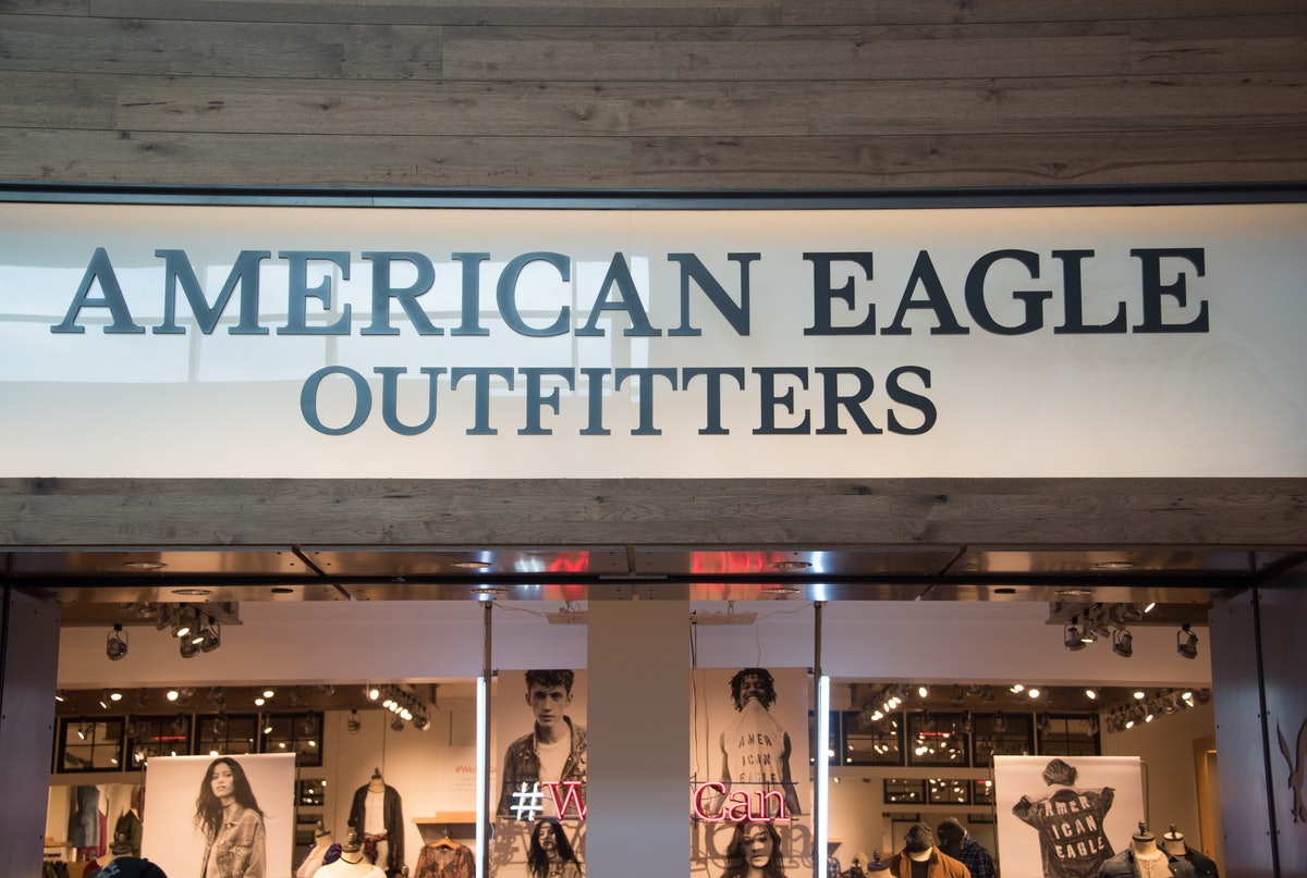 The American Eagle storefront has a big sign and posters of the models.