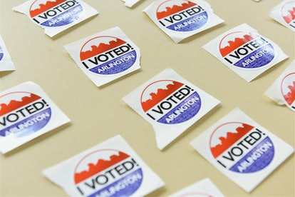 """A series of """"I voted"""" stickers on a table."""