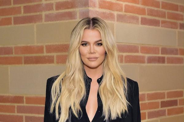 Khloe Kardashian rocks a black pantsuit.