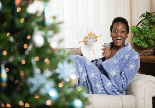 woman opening holiday gift