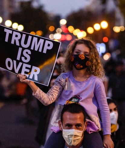 A picture of a little girl celebrating Donald Trump's loss in the 2020 US election