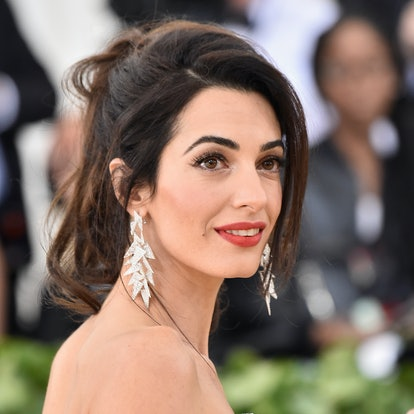 Amal Clooney's most iconic hairstyles: Met Gala 2018 ponytail.