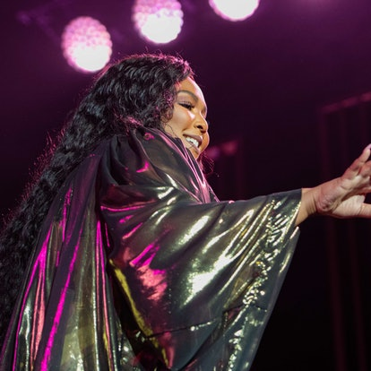 Lizzo performs at a concert. Expressing yourself can be hard, but it's an important form of self-love.