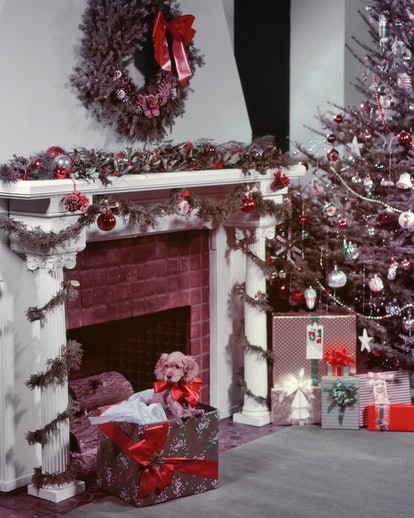 This vintage photo of Christmas decor features a tree with tinsel