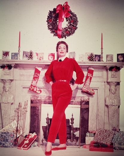 This vintage photo of Christmas decor features stockings and a card display