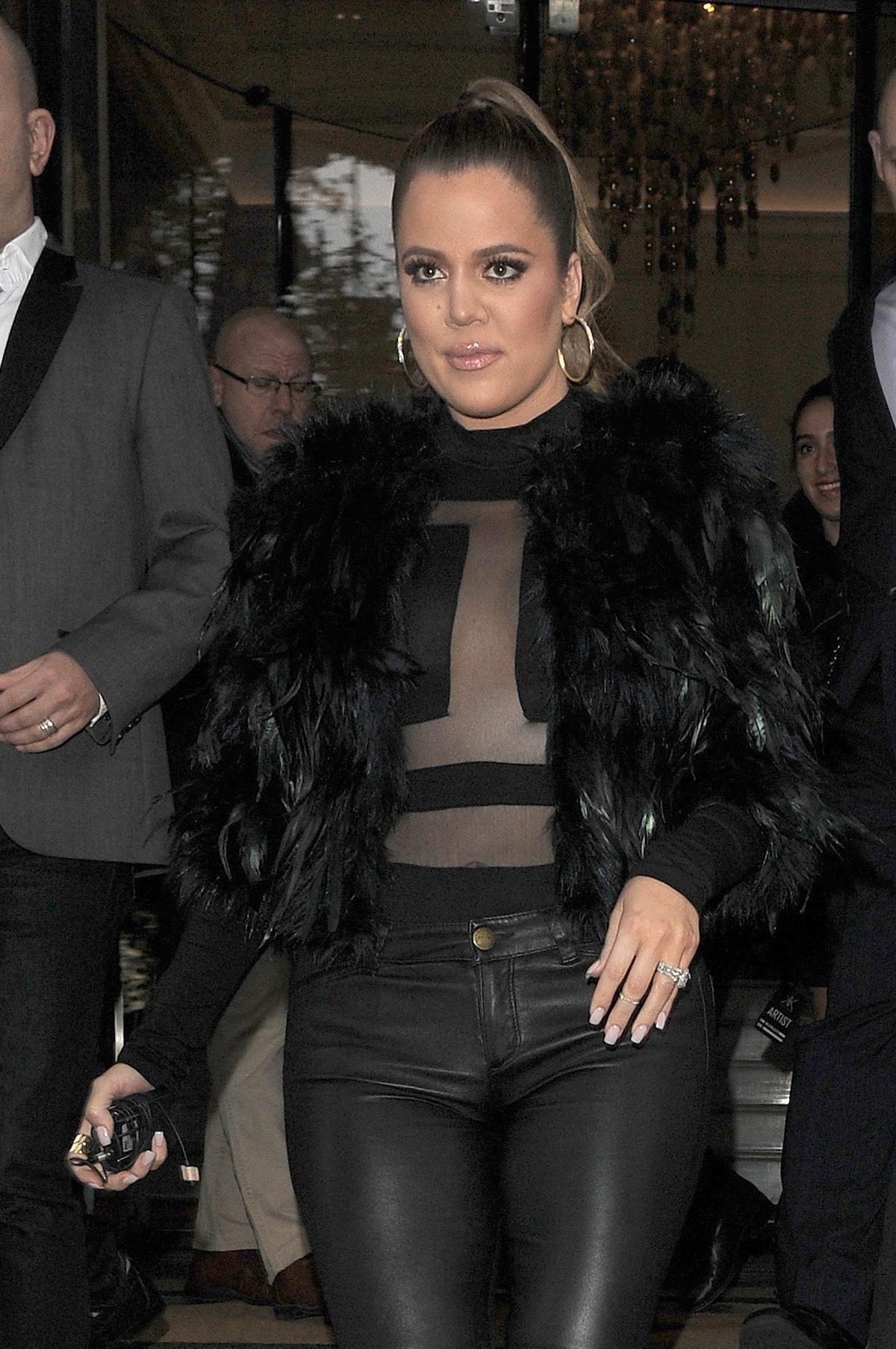 Khloe Kardashian steps out in a fur jacket.