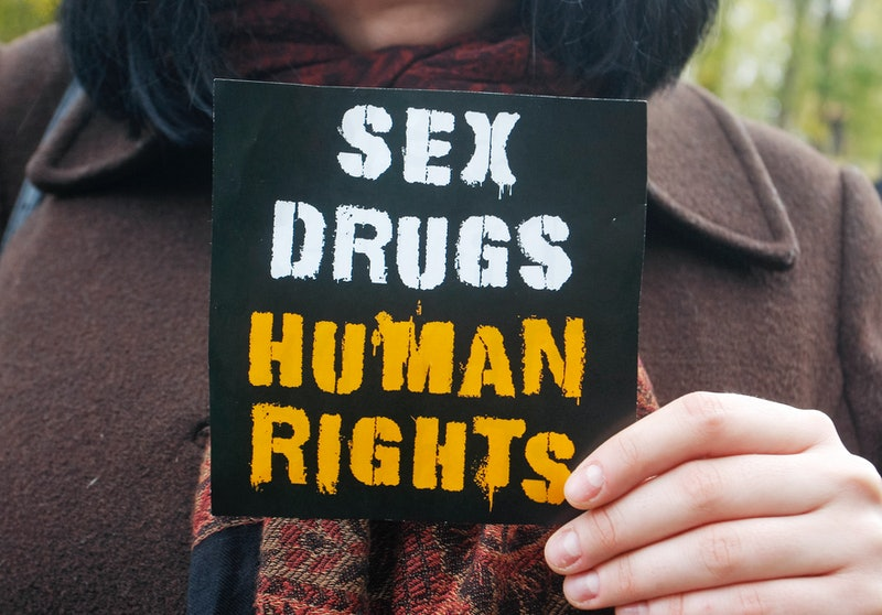 "A person holds up a small sign that reads, ""sex, drugs, human rights."" Decriminalizing drugs in the 2020 election is a huge victory for public health and racial justice."