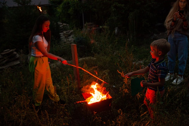 kids roasting marshmallows at a bonfire