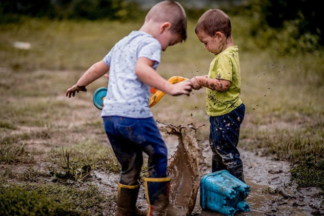 kids playing in mud