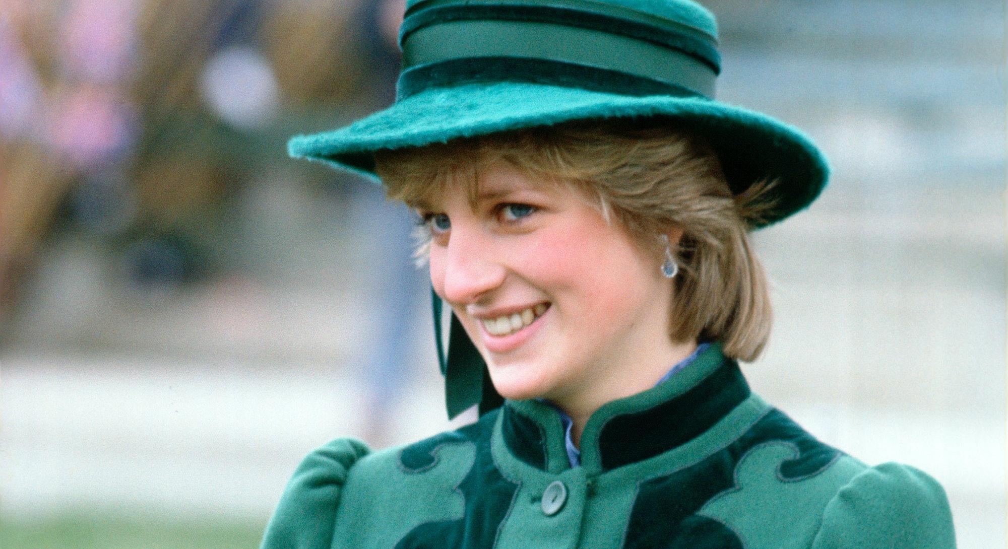 Princess diana in a green maternity coat
