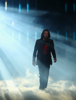 Keanu Reeves walking on stage during a Cyberpunk 2077 event