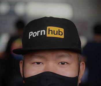 Man wearing a Pornhub hat.