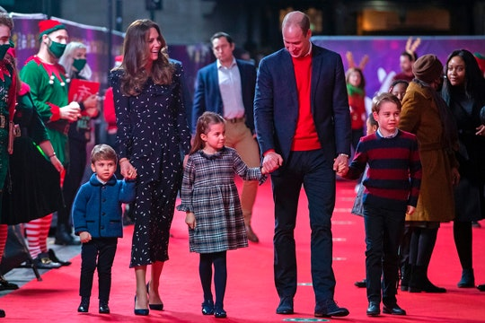 The Cambridge family walks the red carpet.