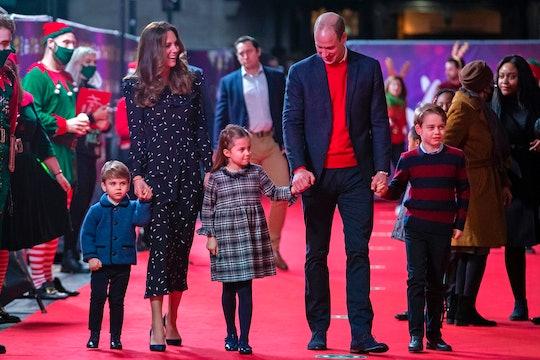 The Cambridge family walks the red carpet.