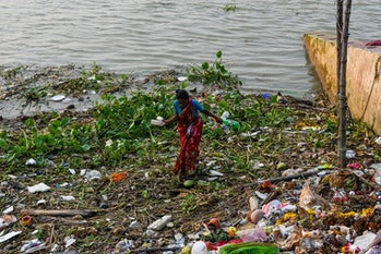 Plastic pollution in on the shore of the Ganges