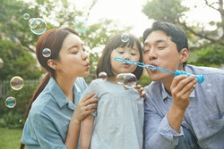family blowing bubbles