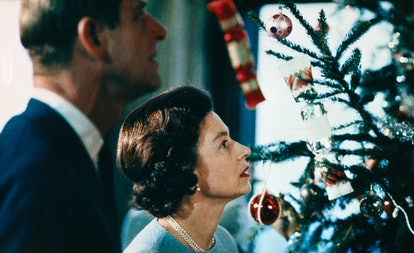 Prince Philip and Queen Elizabeth look at their Christmas tree at Buckingham Palace, 1969.