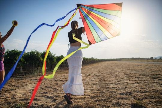 woman flying kite
