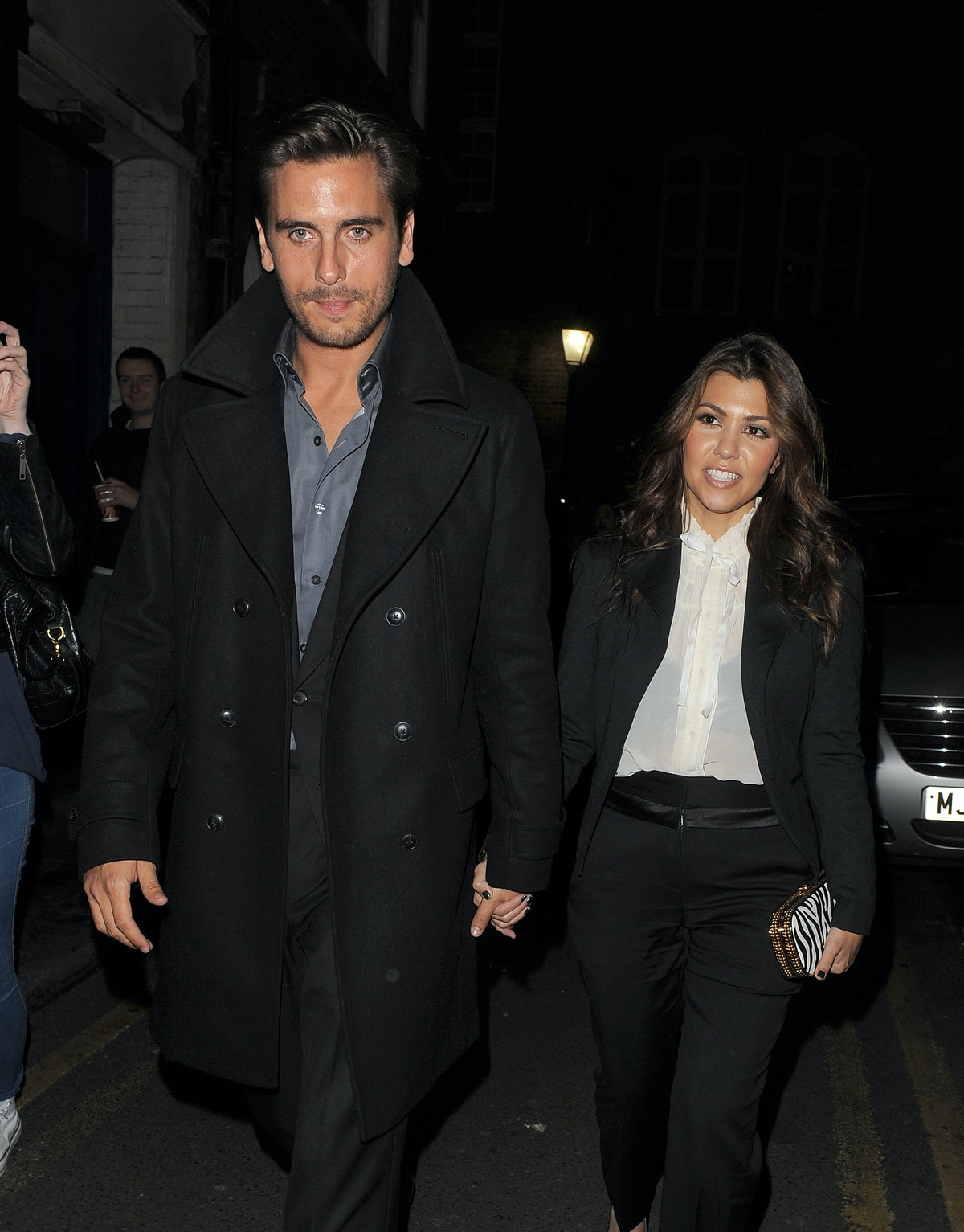 Scott Disick and Kourtney Kardashian step out hand in hand.