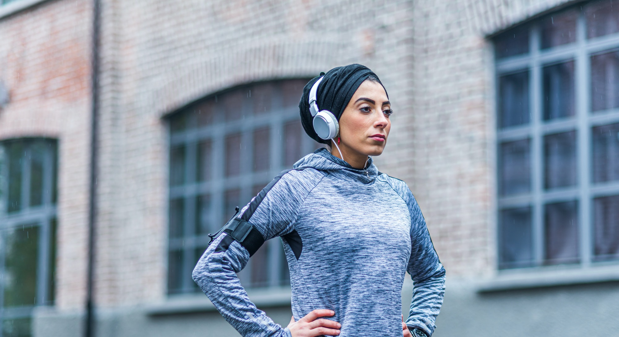 A woman in hijab rests during a run. Strava's 2020 year in sport data shows how much women worked out in 2020 compared to men.