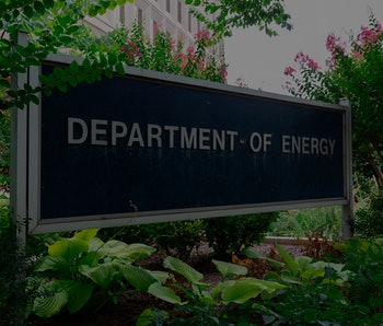Department of Energy sign in front of headquarters.