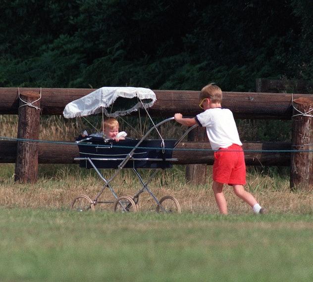 Prince William pushes Princess Beatrice in a pram, 1989.