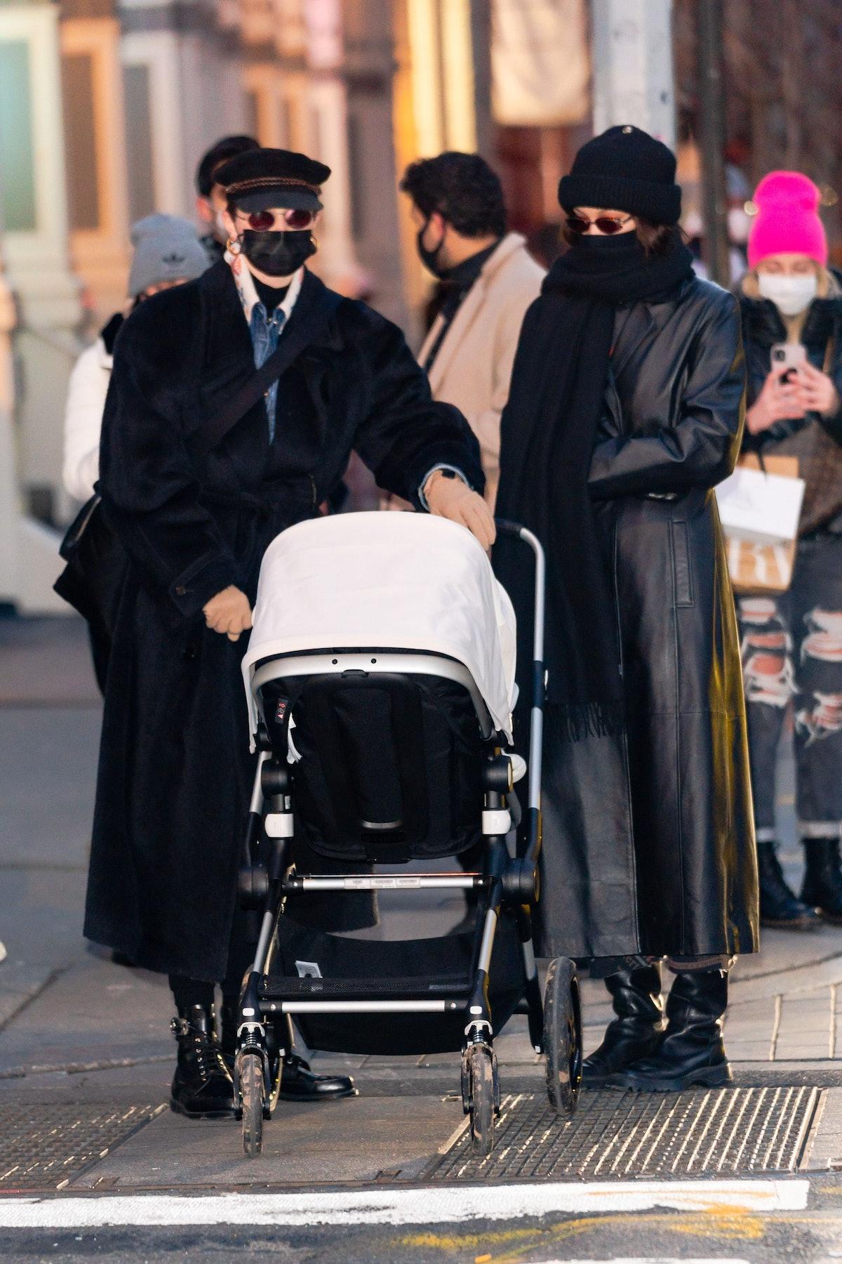 Gigi and Bella Hadid twinned in black duster coats.