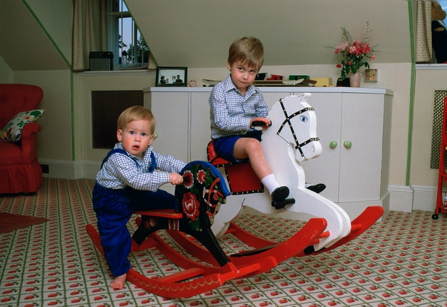 Prince William plays with Prince Harry in 1985.