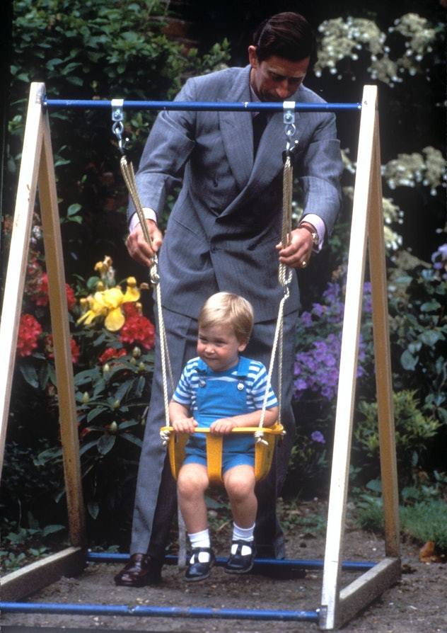 Prince William getting pushed on a swing by his dad in 1984.
