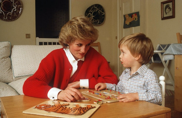 Prince William works on a puzzle with his mom in 1985.