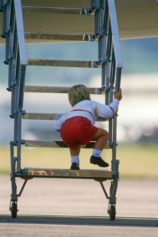 Prince William climbs the stairs on a plane in 1984.