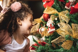 young girl looking at ornaments