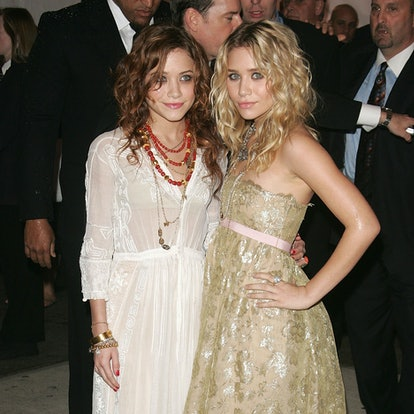 Actresses Mary Kate Olsen (L) and Ashley Olsen attend the MET Costume Institute Gala Celebrating Chanel at the Metropolitan Museum of Art May 2, 2005 In New York City.