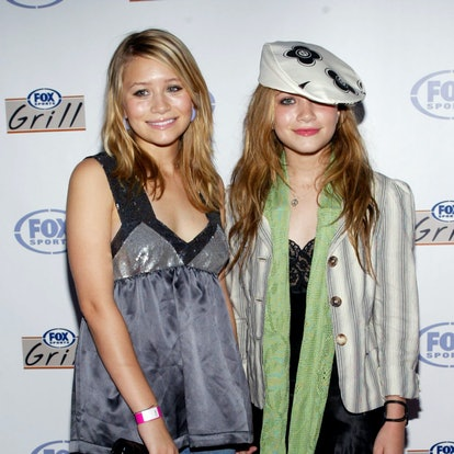 Actors Mary-Kate and Ashley Olsen attend the grand opening of the Fox Sports Grill at the Irvine Spectrum on June 26, 2003 in Irvine, California