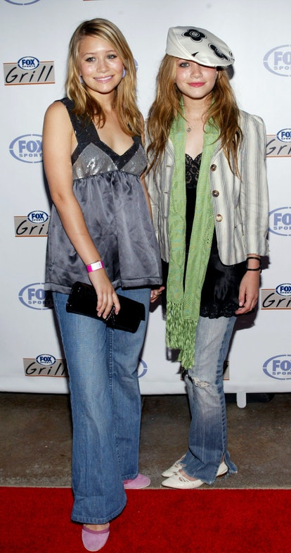 Actors Mary-Kate and Ashley Olsen attend the grand opening of the Fox Sports Grill at the Irvine Spe...