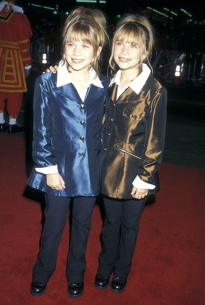 Mary-Kate Olsen and Ashley Olsen attend the Spice World Premiere in 1998.