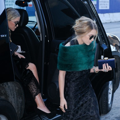 Actresses Mary-Kate Olsen (L) and Ashley Olsen enter Lincoln Center on March 24, 2011 in New York City.