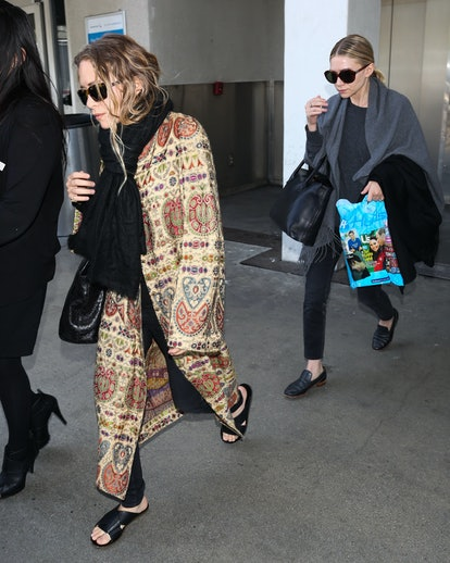 Mary Kate Olsen and Ashley Olsen seen at LAX on May 07, 2014 in Los Angeles, California.