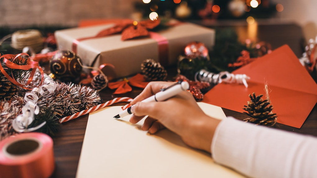 A woman wraps gifts and makes holiday crafts at home.