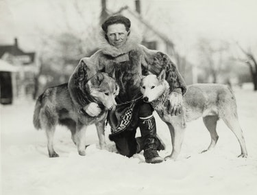 Dog musher Leonard Seppala, of Nome, Alaska with two of his dogs
