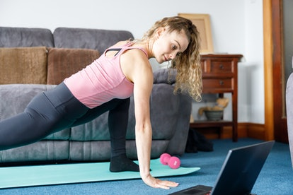 A person works out in her living room at lunch time.
