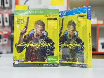 Two packs of Cyberpunk 2077 are seen on a white countertop. The games are still sealed and possibly are returns from customers seeking refunds.