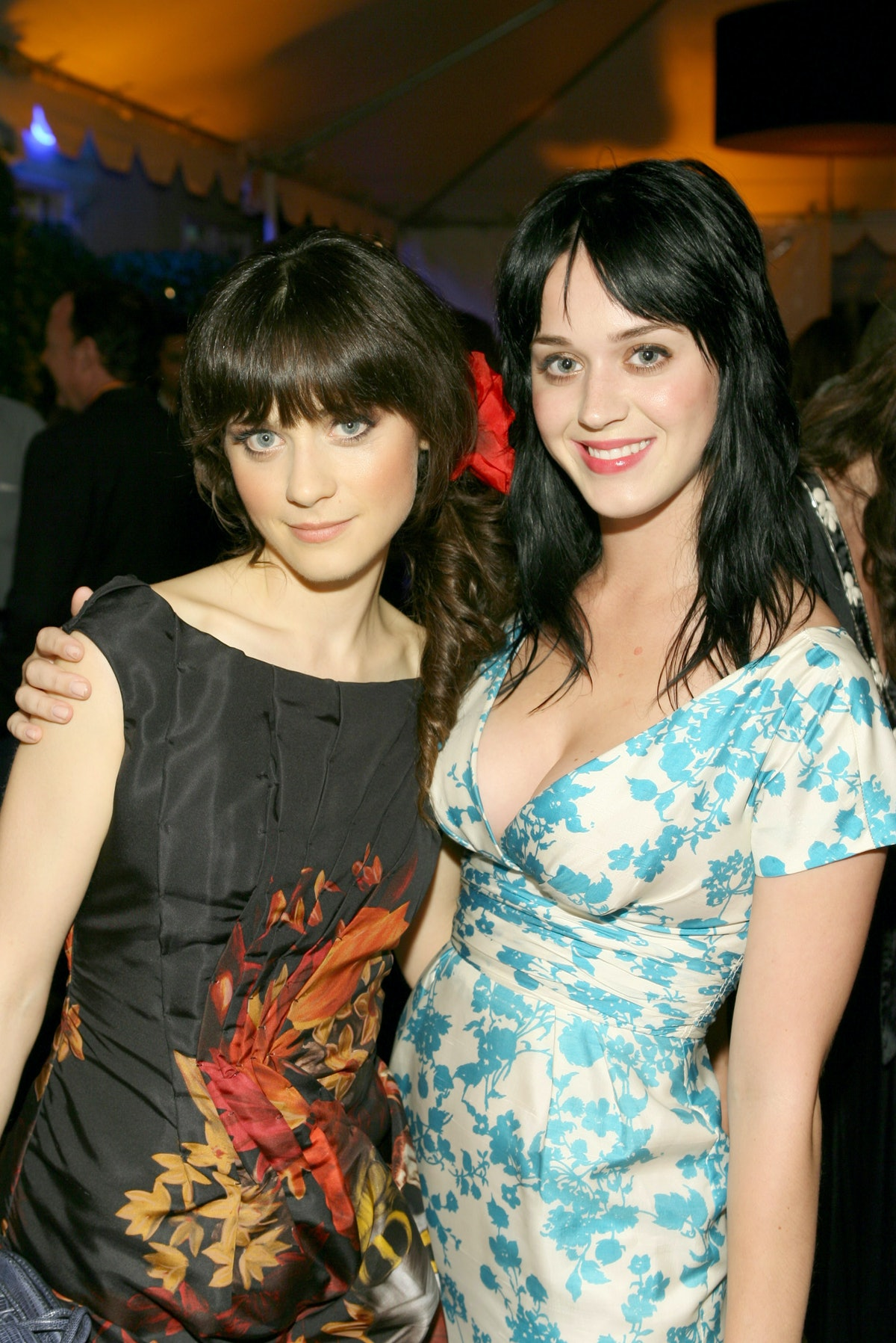 Katy Perry and Zooey Deschanel, who look shockingly similar, pose for a photo at a party.