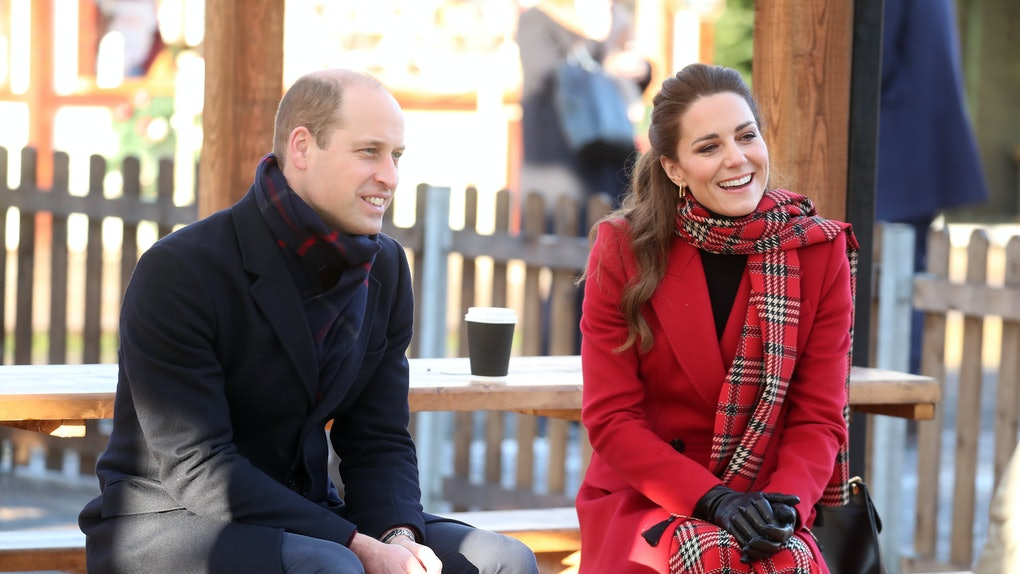 Prince William and Kate Middleton sit at a picnic table during the winter.