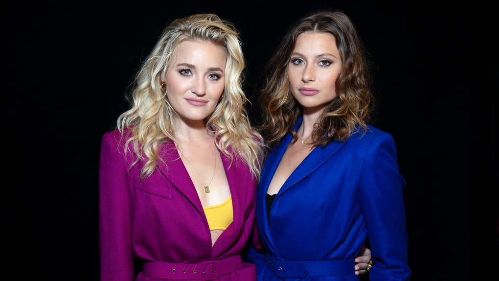 Aly & AJ wear colorful suits.