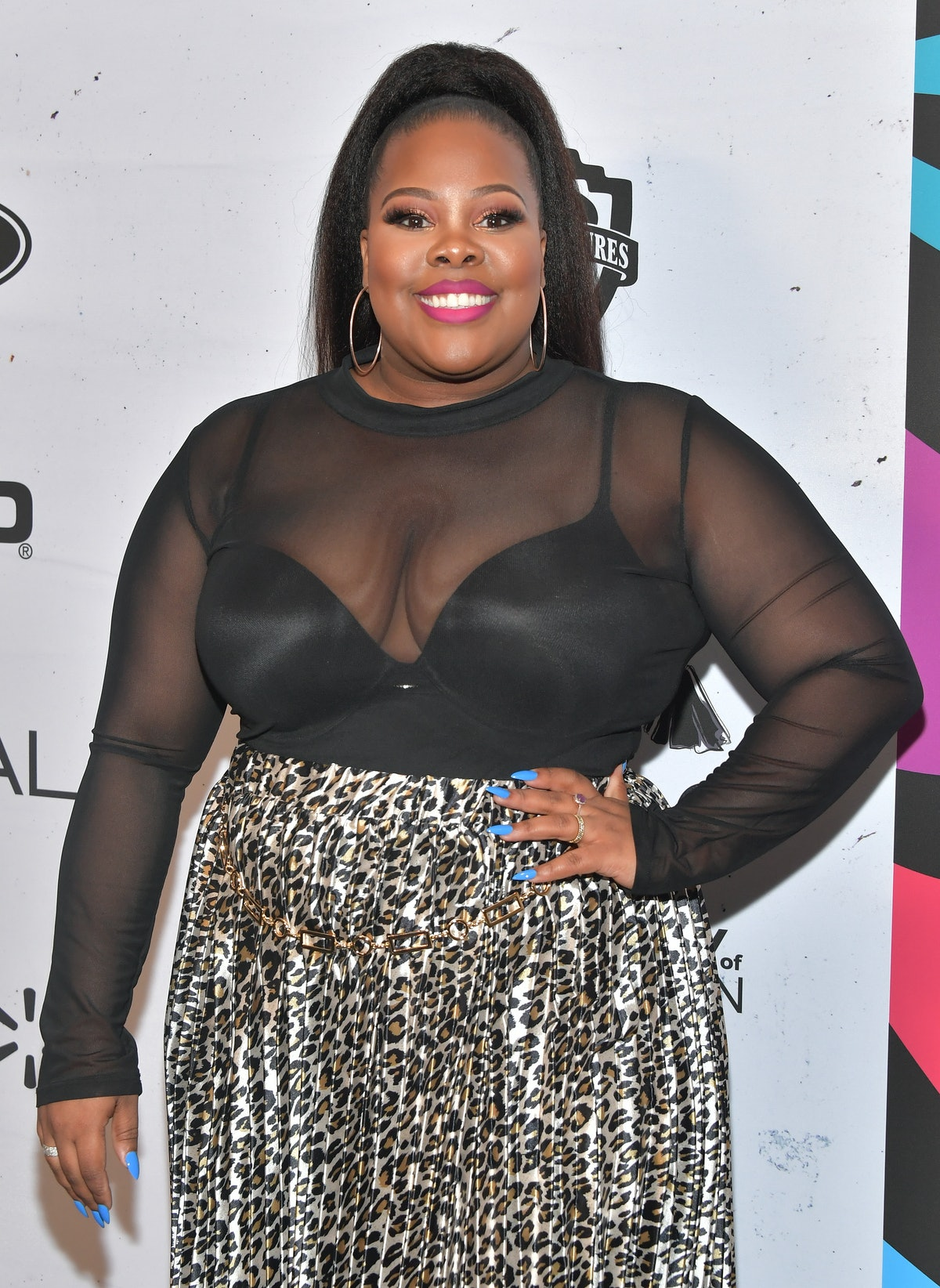 Amber Riley hits the red carpet.