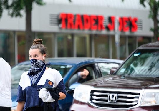 woman outside of trader joe's