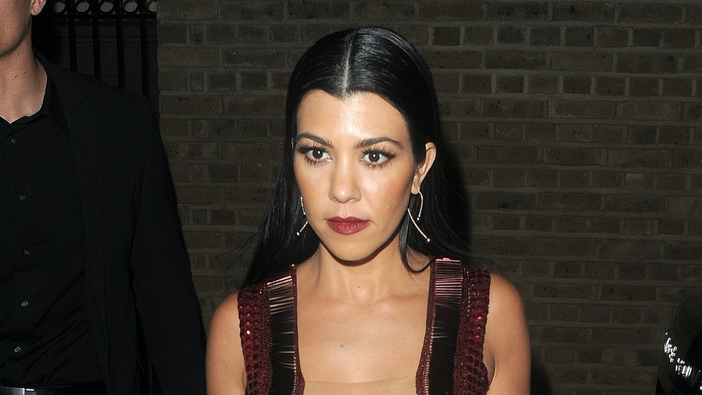 Kourtney Kardashian steps out in a gown with a plunging neckline.