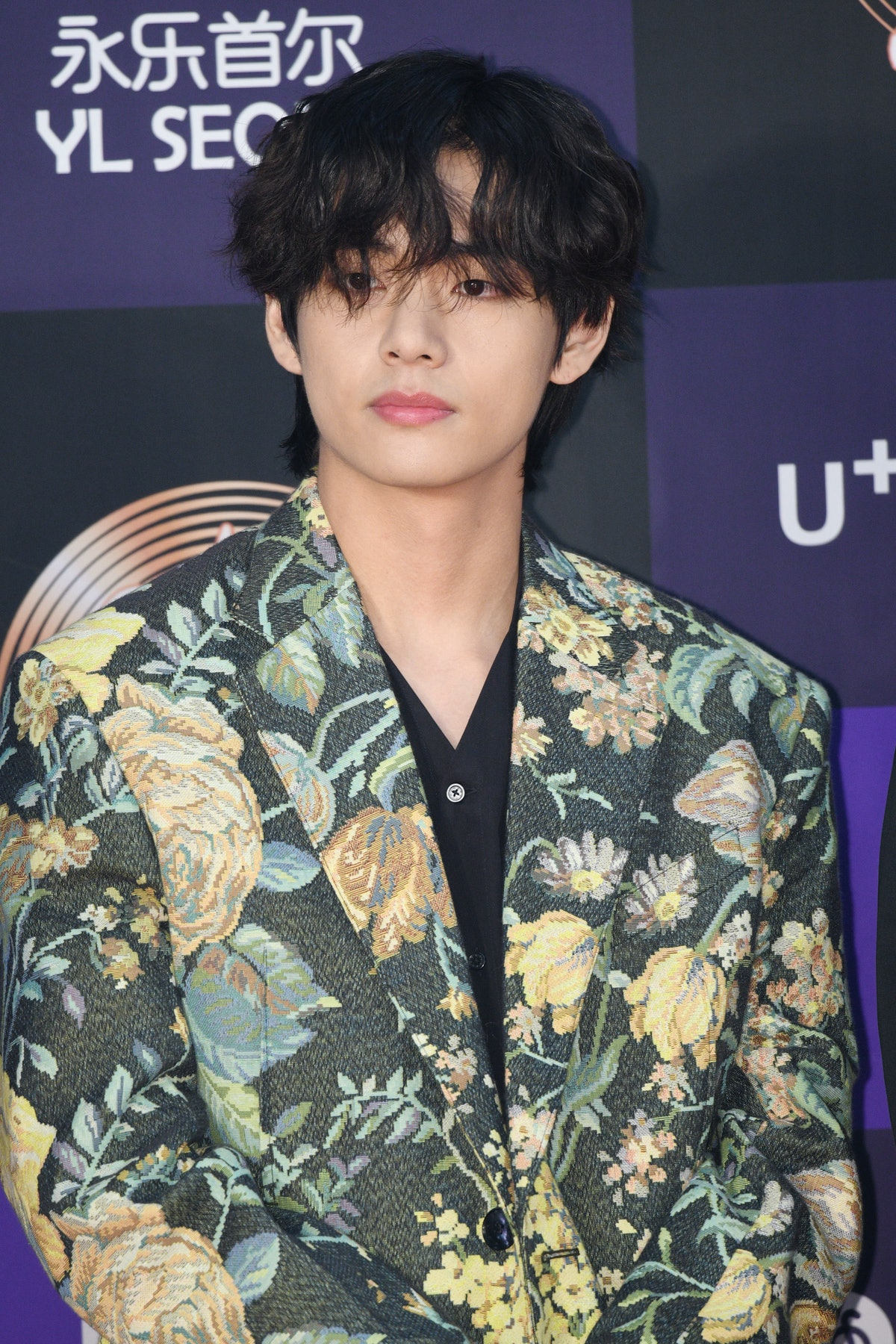 BTS' V hits the red carpet in a floral blazer.